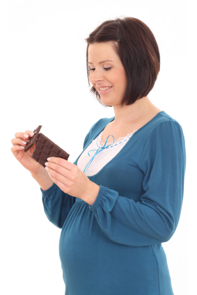 Pregnant woman eating chocolate